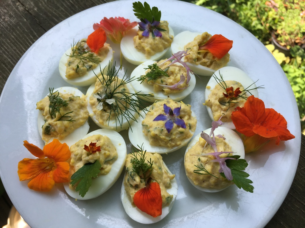 Edible flowers with deviled eggs